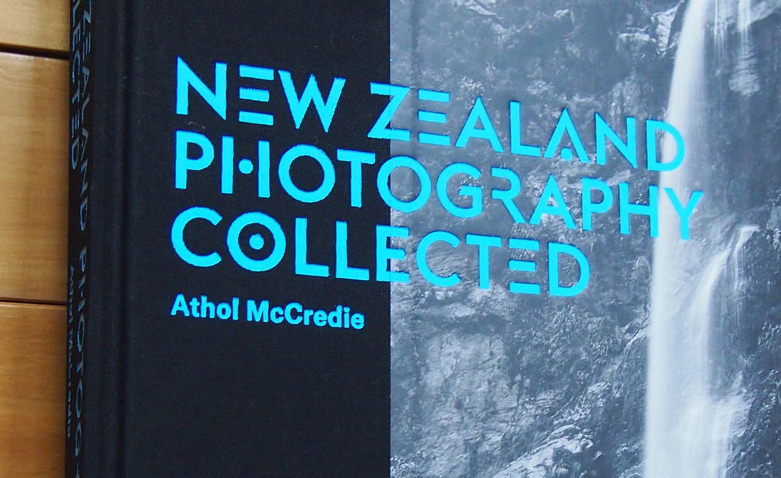 Detail of embossed text over linen, New Zealand Photography Collected, book review by James Gilberd Photospace Gallery