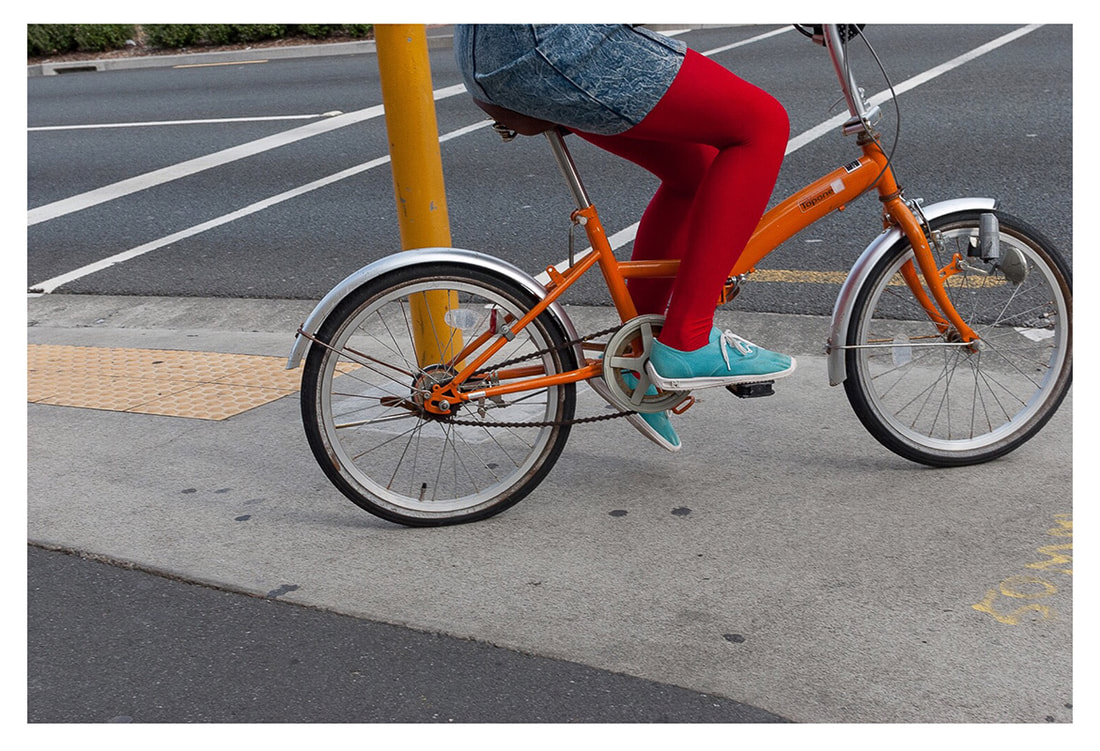 Peter Black - untitled 15, April 2020, A Month of Sundays - Responses to the Covid-19 Lockdown' online exhibition at PhotospaceGallery.nz, photography during covid-19 lockdown in New Zealand, woman in red tights on bicycle