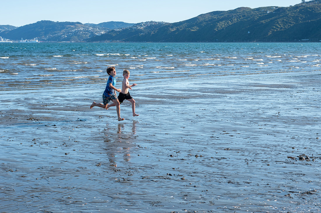 Peter Black - untitled 21, May 2020, A Month of Sundays - Responses to the Covid-19 Lockdown' online exhibition at PhotospaceGallery.nz, photography during covid-19 lockdown in New Zealand, two boys running on Petone beach during Alert Level 3 Petone New Zealand