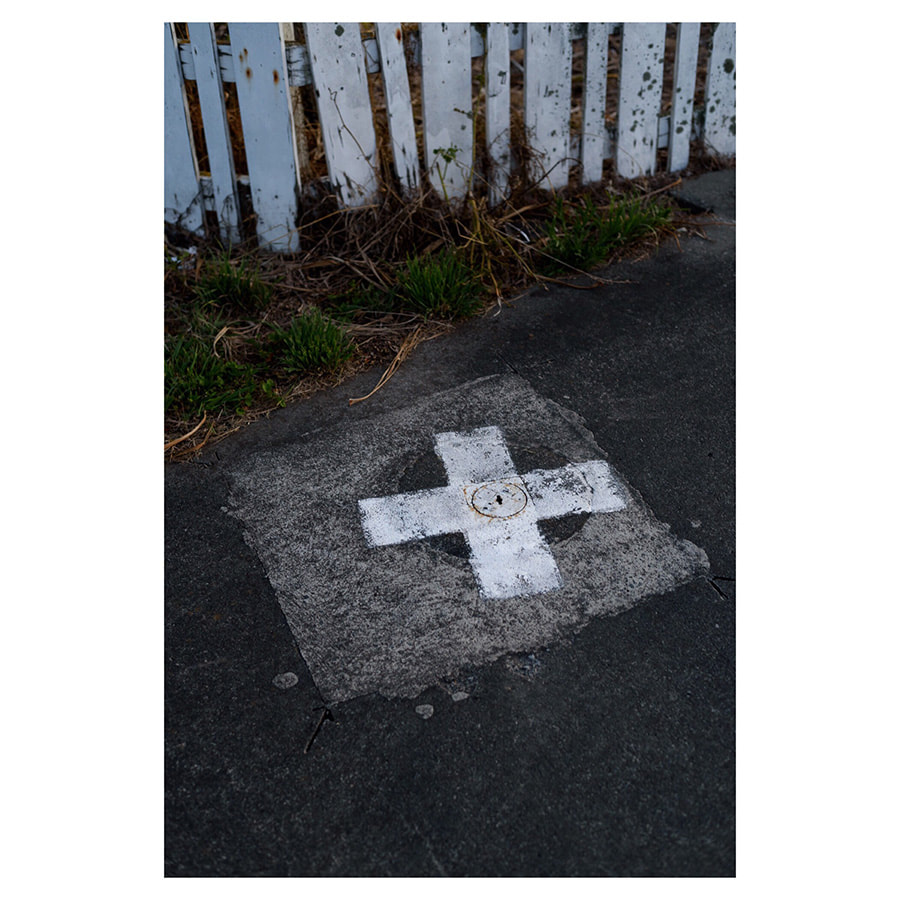 Peter Black - untitled 3, April 2020, 'A Month of Sundays - Responses to the Covid-19 Lockdown' online exhibition at PhotospaceGallery.nz, cross on road