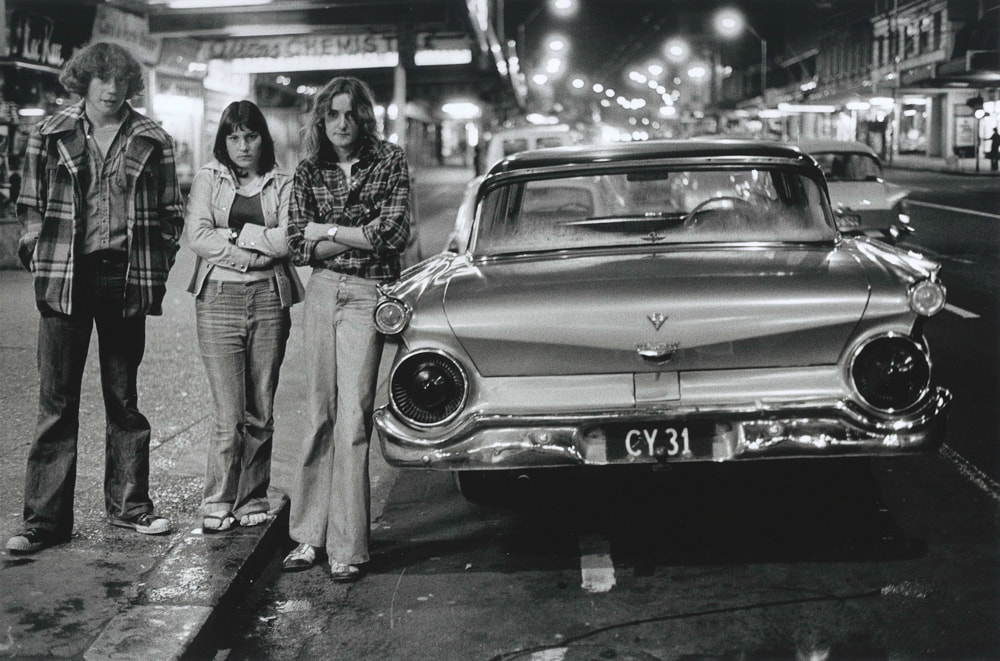 Murray Cammick - 'Ray Fritchit (left) & his 1959 Ford CY31 - 1976', Flash cars exhibition Photospace Gallery 37 Courtenay Place Wellington Aotearoa New Zealand, New Zealand contemporary photography gallery Wellington NZ, NZ car culture, Auckland 1970s street photography